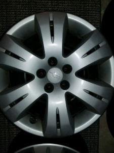 "4- 16"" Subaru steel rims and hubcaps"