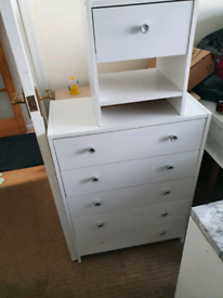 chest of drawers and bedside
