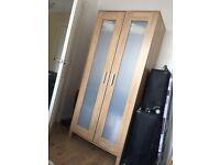 Ikea oak effect wardrobe.