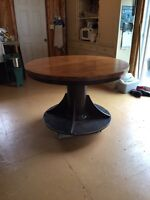 Round pedestal table with chairs