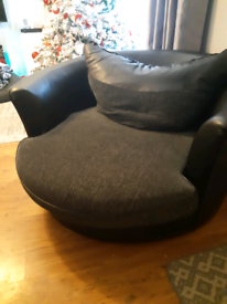 Large black leather cuddle chair
