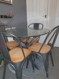4 x metal chairs and glass top table