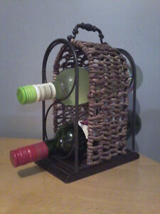 TWO WROUGHT IRON WINE OR TOWELS RACKS