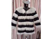 fox fur coat,black and gray