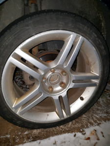4 Audi rims with Volkswagen adapters
