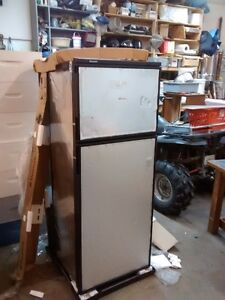 New 9 cu ft propane rv fridge