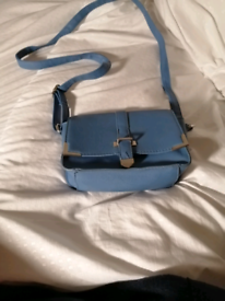 For sale blue hand bag small nice for going out