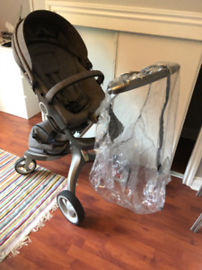 Stokke Xplory Stroller, cradle attachment, and winter extras.