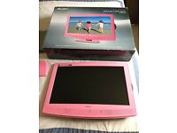 """Pink 22"""" TV/DVD player and wall bracket"""