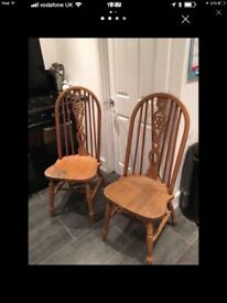 Two large pine chairs