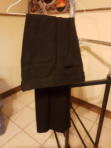 Several pairs of work wear pants and jeans