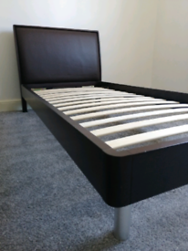 Single bed with mattress & protector. Leather & dark wood headboard.