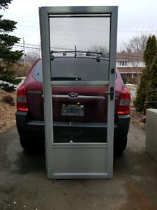 """For sale: 32""""× 80"""" Aluminum storm door."""