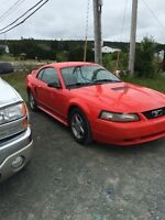 2001 Ford Mustang red Coupe (2 door)