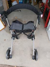 4 Wheeled foldable walker