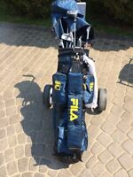 Set of Spalding golf clubs with bag and cart