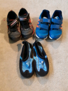 Size 12 boys running shoes an a pair of water shoes