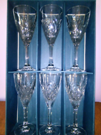 Set of 6 lead crystal cut wine glasses.