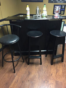 Black bar with 3 chairs