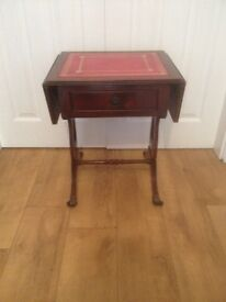 Stunning red leather topped mahogany drop leaf occasional table on wheels