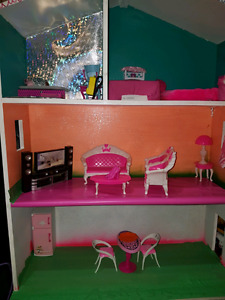 Doll house with a lot of things
