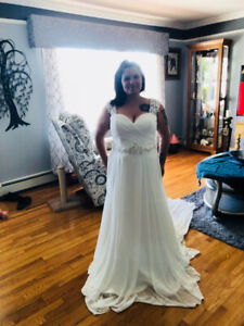 Beautiful wedding dress. Size 18. Only worn for these photos