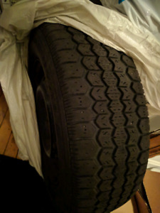 4 winter tires with rims. P185/70R14