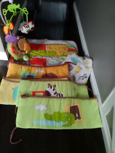 Infant crib set with matching mobile.