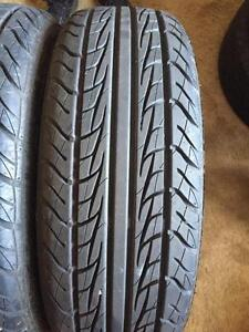 4 - Uniroyal Tiger Paw All Season Tires - 195/65 R15 with Excellent Tread