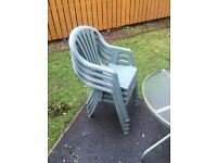 4 green garden chairs and table