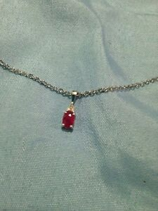 Ruby and diamond necklace and earrings set