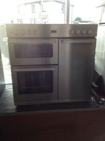 Reconditioned range dual fuel cooker