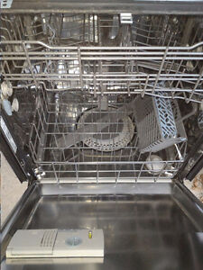 Maytag dishwasher. White outside and stainless steel inside