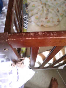 Baby crib with a mattress
