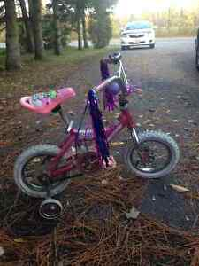 Girls bike with training wheels with bells and whistles