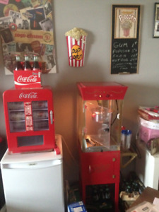 Popcorn machine with accessories and Coca Cola cooler