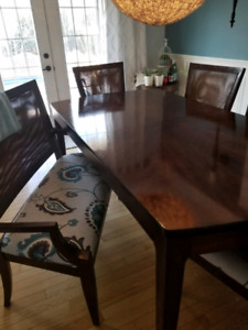Dining Room table with 4 chairs and a bench