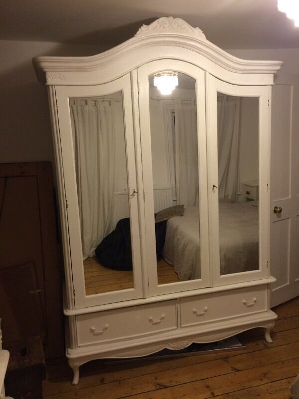 Two gorgeous white french armoires white wooden wardrobes for Double mirror effect