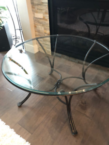 Glass top table with black wrought iron base - $25