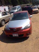 Parting out 2 05 Mazda3 hatchbacks and 2 sedans!!