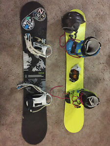 2 snowboards with 1 pair of boots, 1 helmet,1 pair of goggles