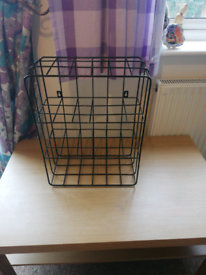 Small black metal free standing shelf also attach to wall