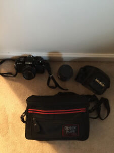 Minolta X-570 camera with zoom lens and carrying case