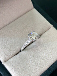 Beautiful  engagement ring and wedding rings