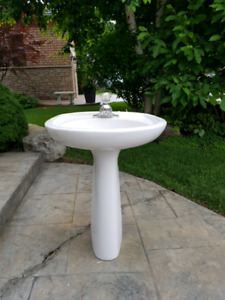 Pedestal sink with moen faucet and drain