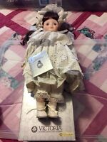 Victoria Impex Corporation Musical Porcelain Doll