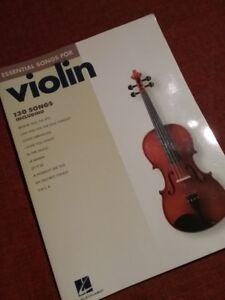 Livre de violon comportant 130 chansons.