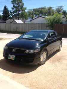 2009 Honda civic coupe DX 4 winter tires, low kms