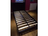 Single black faux leather bed