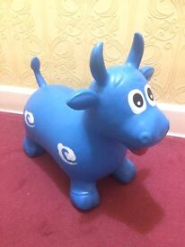 Bouncy inflatable hopper cow ride on